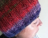 Warm wool mix Noro hat in red, purple and green colors