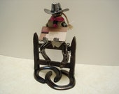 Cowgirl Collectable holding business cards