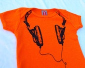 New Skool Orange and Black Headphone Onesie. Available sizes: 3-6m, 6-12m, 12-18m. 16usd plus shipping. Please specify the size you want.