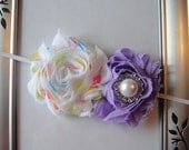 """Purple and multicolor shabby roses with pearl gemstone attached to a matching white skinny 1/8"""" headband."""