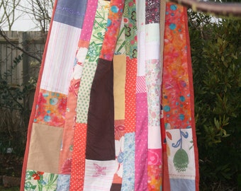 Bespoke quilt made from upcycled children's clothes