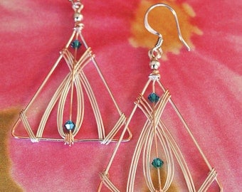 Triangular earrings made with silver-plated wire accented with tiny turquoise swarovski crystals.