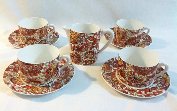 Vintage Chamart coffee cups, saucers and creamer/milk jug with orange paisley pattern