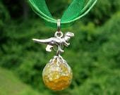Dinosaur Fried Marble Orange Charm on Green Ribbon Necklace