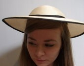 Cream boater style vintage hat with black trim circa 1960