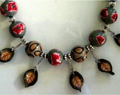 Necklace with flower beads and leafs from polymer clay spring