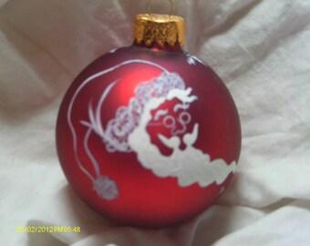 Handpainted Santa face on a Christmas ball
