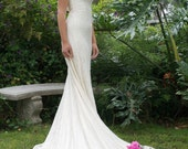 Absoultly stunning ivory and gold lace gown.  Front and back cowell neck and gorgeous train.