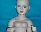 Porcelain, bisque doll head and upper body.