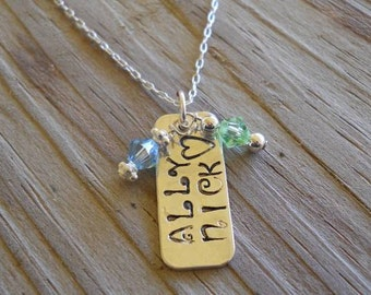 Hand stamped sterling silver necklace with  swarovski crystals.