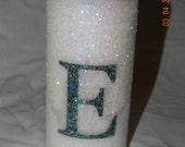Candle - white 6 inch pillar, decorative glitter, monogram E, coconut citrus scented