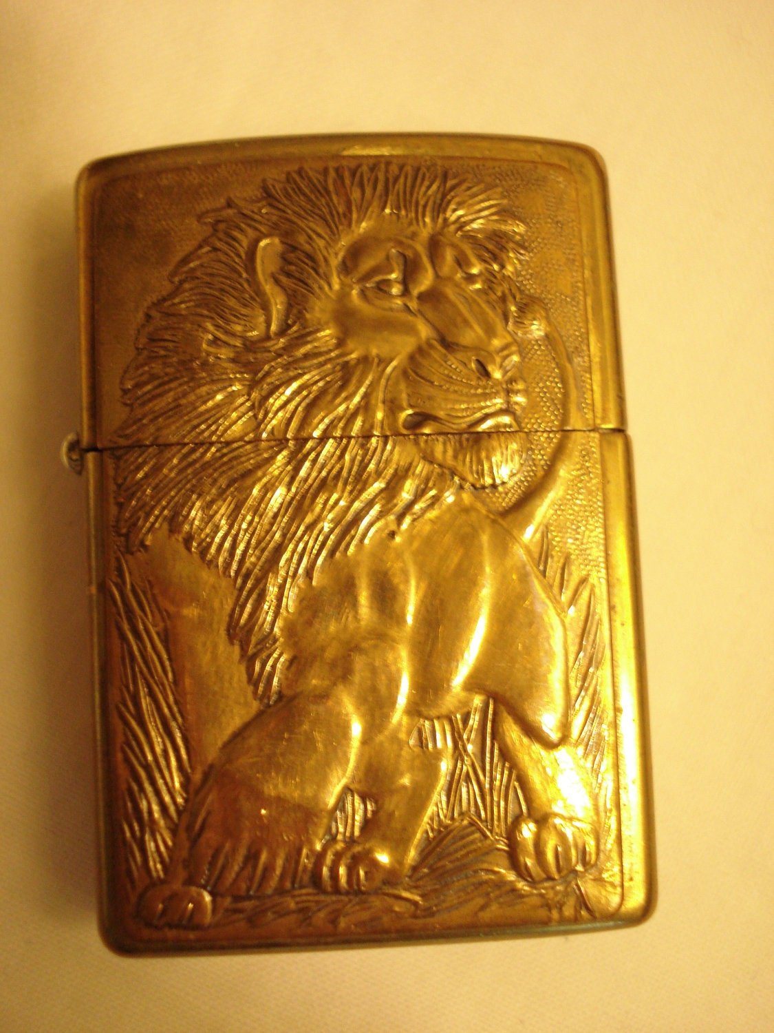 Vintage Zippo Lighter In Brass With Embossed Lion