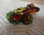 Miniature handmade glass frog on lily pad