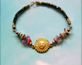 Braided leather Bracelet with a gold metal sun & stone-, silver bead decor. No. 3