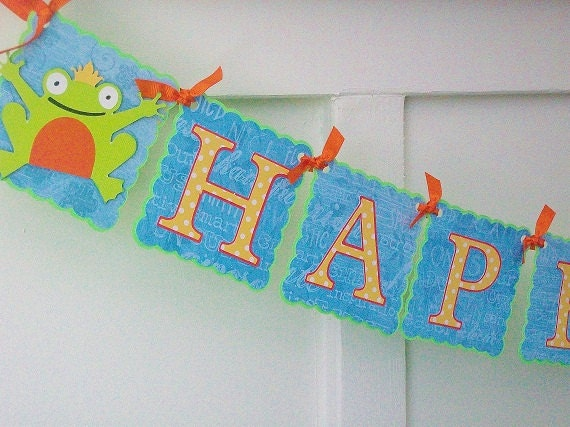 Frog Prince HAPPY BIRTHDAY Paper Party Banner In Blue, Green and Orange With Polka Dot Lettering