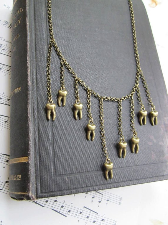 Gold tooth hanging chain necklace perfect for roller derby or just to make a statement.