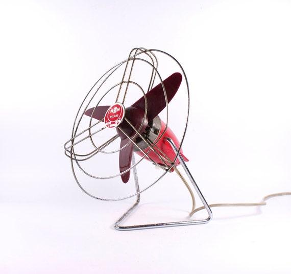 Vintage burgundy table fan. Industrial
