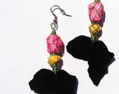 Black suede Africa with bright pink and apricot stones wrapped in lime green wire