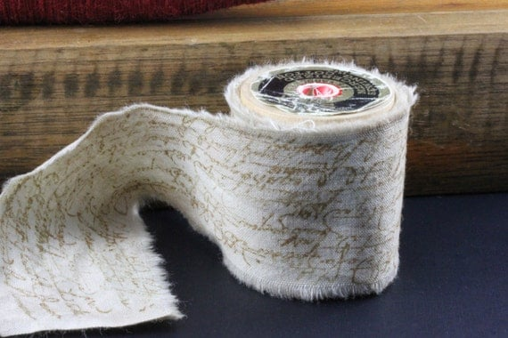 Oh The Charm Of Vintage Script - Vintage Inspired Hand Stamped Tea Dyed and Frayed Muslin Fabric Trim Around A Vintage Wooden Spool