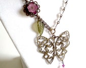Antique brass, Lucite flower and Swarovski asymmetrical butterfly garden necklace