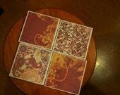 Handmade Ceramic coaster set (4) burgundy, gold, yellow, cream swirls, paisley