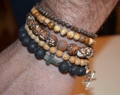 Men's set of 5 semi precious stone and lava beaded bracelets with cross and skull charm accents.