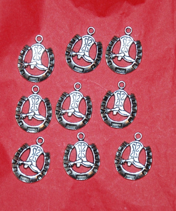 Nine antique silver cowboy boot in horseshoe charms.  Great for jewelry making or scrapbooking.