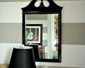 Glossy black mid century mirror