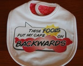 Toddler Size Bib - These Fools Put My Cape On Backwards
