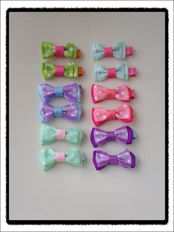 cute little bow baby hair clips. You pick two.