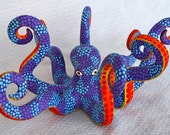 brightly painted wooden octopus