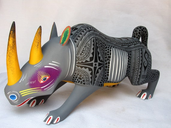 brightly painted wooden rhino