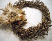 Grapevine Wreath with feathers and burlap flower