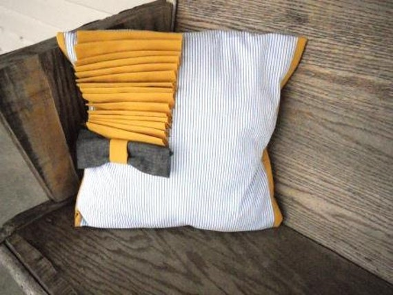 White, blue, mustard yellow and grey decorative pillow with grey bowtie