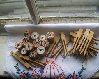 12 Vintage Clothespins and 12 Wooden Thread Spools.