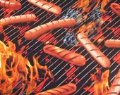 Hot Dogs on the barbecue grill. Fat quarter of fabric
