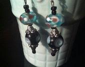 Funky vintage feel, Lampwork blue and black beaded earrings.