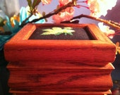 Wood and cross stick jewelry box.