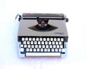 Gray pastel vintage typewriter Nippo P-200 portable back to school