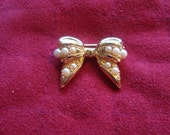 "Item is now on sale.   Joan Rivers Collection Pin  "" Pearl Bow""."