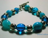 Blue & Silver Bracelet: Bright Blue and Light Blue Glass Beads with silver tone metal beads