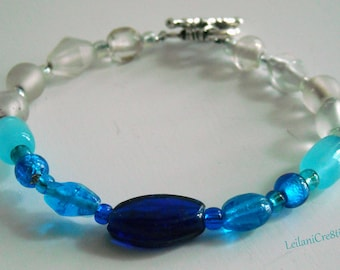 Royal Blue Bracelet with  Aqua, Ice Blue, Clear, and Frosted Clear Glass Beads