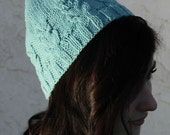 Turquoise knitted hat with vintage owls