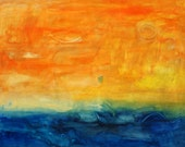 Orange sky over a blue ocean, abstract.