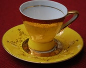 Yellow mini tea cup and Saucer by Trina