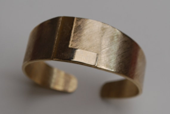 Chunky gold  cuff bracelet with monogram L