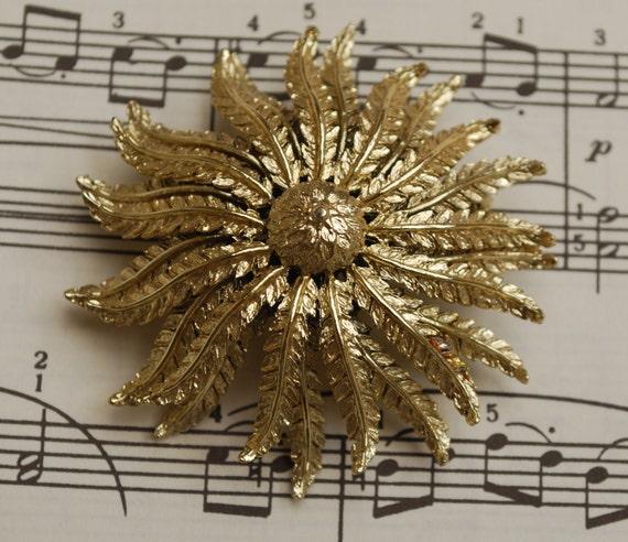large goldtone metal flower brooch