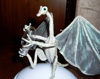 Dragon Glowbug, What makes it light up? Devils Claw Dragon Art Doll