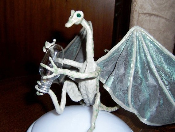 Dragon Glowbug, What makes it light up? Devils Claw Dragon Art Doll