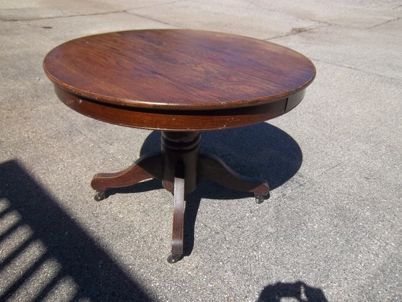 antique round dark wood dining table from h c niemann co early 1900